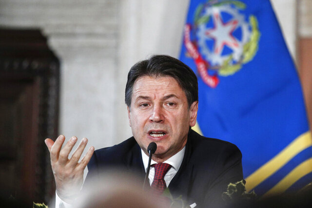 Italy's premier Giuseppe Conte speaks during his year-end press conference at Villa Madama, in Rome, Saturday, Dec. 28, 2019. Conte insists his squabbling coalition will last three more years, even after a minister recently quit in protest. (Giuseppe Lami/ANSA via AP)