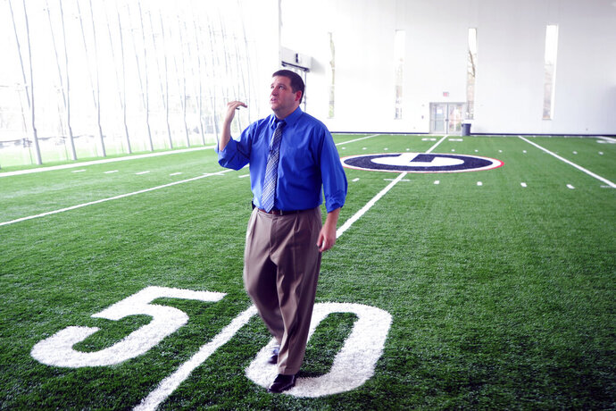 FILE - In this Jan. 26, 2011, file photo, Josh Brooks, then-University of Georgia assistant athletic director for internal operations, points out some of the renovations to the UGA Athletic Association's Butts-Mehre Heritage Hall in Athens, Ga. Brooks has been named Georgia's full-time athletic director less than one week into his stint as the interim replacement for Greg McGarity. (David Manning/Athens Banner-Herald via AP, File)