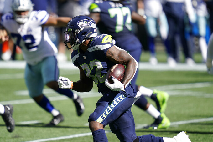 Seattle Seahawks unning back Chris Carson rushes against the Dallas Cowboys during the first half of an NFL football game, Sunday, Sept. 27, 2020, in Seattle. (AP Photo/Elaine Thompson)