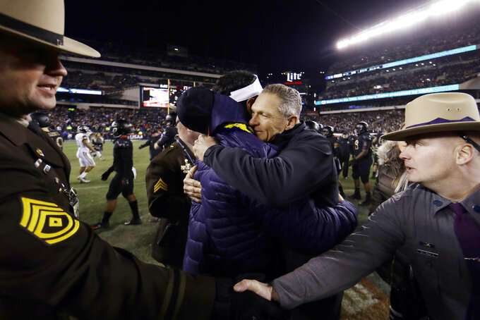Army head coach Jeff Monken, right, embraces Navy head coach Ken Niumatalolo after an NCAA college football game, Saturday, Dec. 8, 2018, in Philadelphia. Army won 17-10. (AP Photo/Matt Slocum)