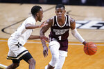 Mississippi State guard Iverson Molinar (1) is guarded by Vanderbilt guard Trey Thomas, left, in the second half of an NCAA college basketball game Saturday, Jan. 9, 2021, in Nashville, Tenn. (AP Photo/Mark Humphrey)