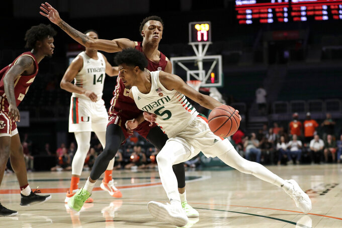 Miami guard Harlond Beverly (5) drives to the basket as Boston College forward Kamari Williams defends during the second half of an NCAA college basketball game, Wednesday, Feb. 12, 2020, in Coral Gables, Fla. Miami won 85-58. (AP Photo/Lynne Sladky)