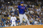 New York Mets starting pitcher Taijuan Walker throws to first after getting hit by a line drive hit by Los Angeles Dodgers' Justin Turner during the sixth inning of a baseball game Thursday, Aug 19, 2021, in Los Angeles. (AP Photo/Ashley Landis)