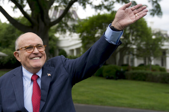 FILE - In this Tuesday, May 29, 2018 file photo, Rudy Giuliani, an attorney for President Donald Trump, waves to people during White House Sports and Fitness Day on the South Lawn of the White House, in Washington. Trump's legal team, through an unlikely combination of bluster, legal precedent and a decision to sharply shift tactics, protected their client from a perilous in-person interview and those lawyers took a victory lap this week when a redacted version of special counsel Robert Mueller findings was published, (AP Photo/Andrew Harnik, File)