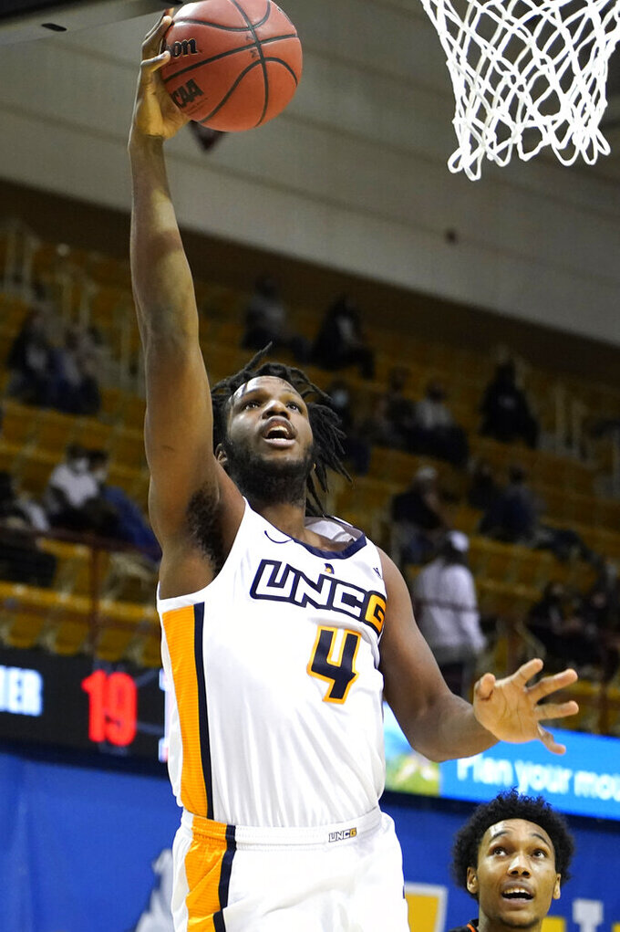 UNC-Greensboro forward Mohammed Abdulsalam (4) leaps to the basket against Mercer in the first half of an NCAA men's college basketball championship game for the Southern Conference tournament, Monday, March 8, 2021, in Asheville, N.C. (AP Photo/Kathy Kmonicek)