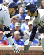 Milwaukee Brewers' Ryan Braun, right, celebrates with Yasmani Grandal after hitting a solo home run against the Chicago Cubs during the fourth inning of a baseball game Friday, May 10, 2019, in Chicago. (AP Photo/Nam Y. Huh)