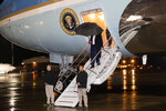President Donald Trump steps off Air Force One, Friday, Nov. 29, 2019, at Ramstein Air Base, Germany. Trump is en route back to his Mar-a-Lago estate in Palm Beach, Fla., after a surprise visit to Afghanistan. (AP Photo/Alex Brandon)