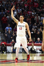 San Diego State forward Nolan Narain gestures after hitting a 3-point shot during during the first half of the team's NCAA college basketball game against Colorado State on Tuesday, Feb. 25, 2020, in San Diego. (AP Photo/Denis Poroy)