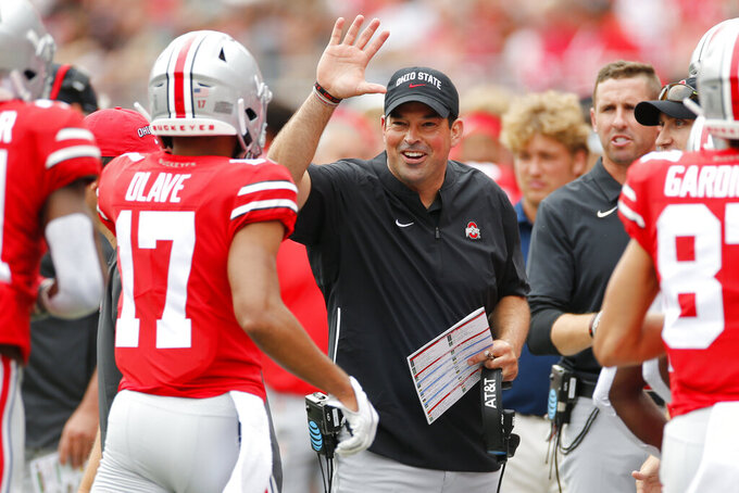 Ohio State head coach Ryan Day, center, celebrates their touchdown against Florida Atlantic during the first half of an NCAA college football game Saturday, Aug. 31, 2019, in Columbus, Ohio. (AP Photo/Jay LaPrete)