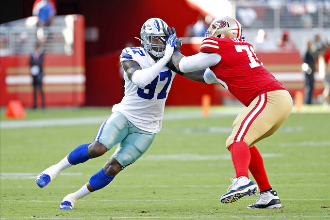 Dallas Cowboys defensive end Taco Charlton (97) rushes against San Francisco 49ers offensive tackle Shon Coleman (78) during a 2019 NFL week 1 preseason game, Saturday, August 10, 2019 in Santa Clara, Calif. The 49ers defeated the Cowboys, 17-9. (James D. Smith via AP)