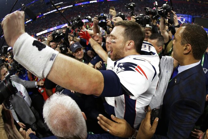 New England Patriots' Tom Brady (12) celebrates on the field, after the NFL Super Bowl 53 football game against the Los Angeles Rams, Sunday, Feb. 3, 2019, in Atlanta. The Patriots won 13-3. (AP Photo/Mark Humphrey)