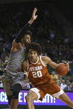 Texas forward Jericho Sims, right, drives into Baylor forward Freddie Gillespie, left, in the first half of an NCAA college basketball game, Saturday, Jan. 4, 2020, in Waco, Texas. (AP Photo/Rod Aydelotte)