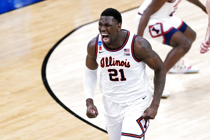 Illinois' Kofi Cockburn screams after scoring against Loyola during the first half of a college basketball game in the second round of the NCAA tournament at Bankers Life Fieldhouse in Indianapolis Sunday, March 21, 2021. (AP Photo/Mark Humphrey)