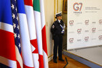 A police officer stands guard at the French Interior Ministry during a G7 meeting at ministerial level in Paris Thursday April 4, 2019. Foreign and interior ministers from the Group of Seven are gathering in France this week to try to find ambitious solutions to world security challenges. Putting a dampener on that are two glaring American absences: U.S. Secretary of State Mike Pompeo and Homeland Security Secretary Kirstjen Nielsen. (AP Photo/Michel Euler)
