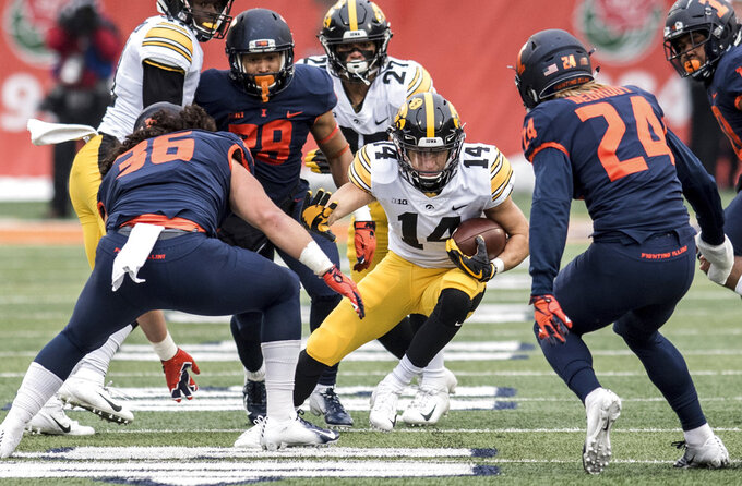 Iowa's Kyle Groeneweg (14) returns the ball against Illinois in the first half of a NCAA college football game, Saturday, Nov. 17, 2018, in Champaign, Ill. (AP Photo/Holly Hart)