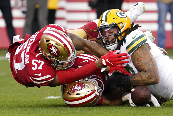 Green Bay Packers offensive tackle Billy Turner, right, recovers a loose ball next to San Francisco 49ers linebacker Dre Greenlaw (57) and Nick Bosa during the first half of the NFL NFC Championship football game Sunday, Jan. 19, 2020, in Santa Clara, Calif. (AP Photo/Tony Avelar)