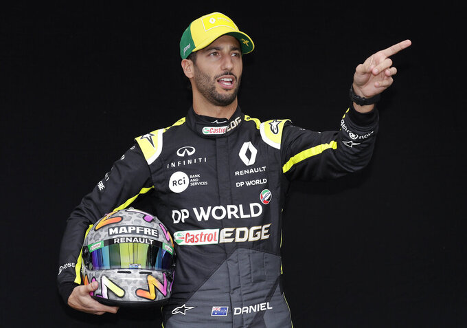 Renault driver Daniel Ricciardo of Australia poses for a photo at the Australian Formula One Grand Prix in Melbourne, Thursday, March 12, 2020. (AP Photo/Rick Rycroft)
