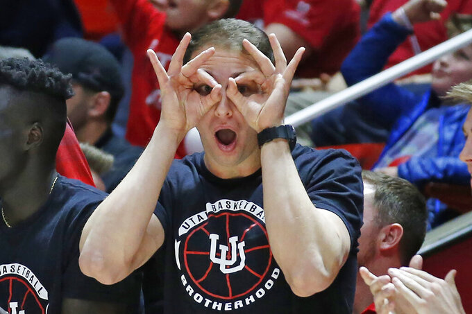 A Utah player on the bench reacts after a Utah score against Stanford in overtime during an NCAA college basketball game Thursday, Feb. 6, 2020, in Salt Lake City. (AP Photo/Rick Bowmer)