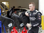 Ty Dillon takes a break outside his garage after a NASCAR auto race practice at Daytona International Speedway, Thursday, July 4, 2019, in Daytona Beach, Fla. (AP Photo/John Raoux)