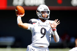 Cincinnati quarterback Desmond Ridder throws a pass against Austin Peay during the first half of an NCAA college football game, Saturday, Sept. 19, 2020, in Cincinnati, Ohio. (AP Photo/Jay LaPrete)
