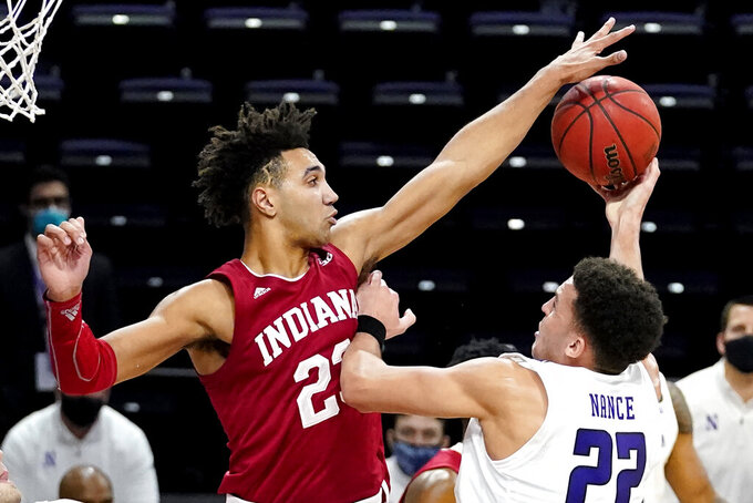 Indiana forward Trayce Jackson-Davis, left, blocks a shot by Northwestern forward Pete Nance during overtime of an NCAA college basketball game in Evanston, Ill., Wednesday, Feb. 10, 2021. Indiana won 79-76 in double- overtime. (AP Photo/Nam Y. Huh)