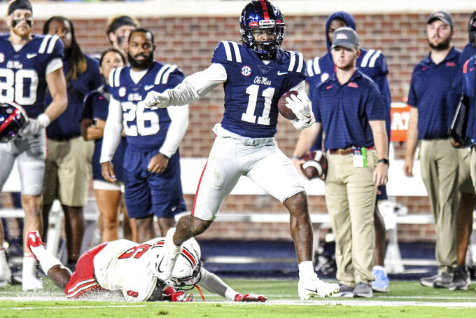 Mississippi wide receiver Dontario Drummond (11) gets away from Austin Peay safety Kory Chapman (6) to score during an NCAA college football game in Oxford, Miss., Saturday, Sept. 11, 2021. (AP Photo/Bruce Newman)
