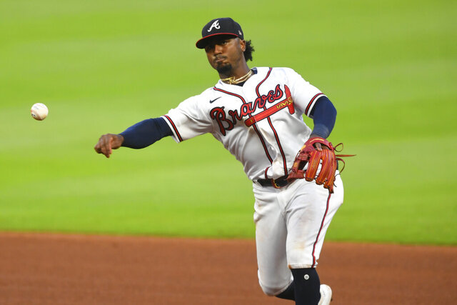 Atlanta Braves second baseman Ozzie Albies Tampa Bay Rays' Joey Wendle at first base during the sixth inning of a baseball game Thursday, July 30, 2020 in Atlanta. (AP Photo/John Amis)