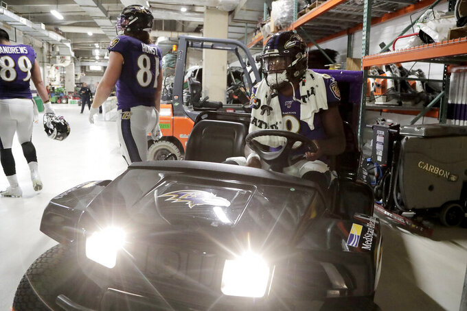 Baltimore Ravens quarterback Lamar Jackson sits on a cart before taking the field prior to an NFL football game against the Cincinnati Bengals Sunday, Oct. 13, 2019, in Baltimore. (AP Photo/Julio Cortez)