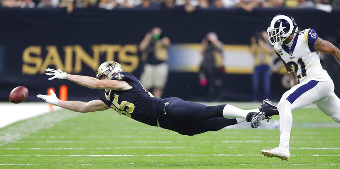 New Orleans Saints' Dan Arnold can't catch a pass in front of Los Angeles Rams' Aqib Talib during the second half of the NFL football NFC championship game, Sunday, Jan. 20, 2019, in New Orleans. (AP Photo/Gerald Herbert)