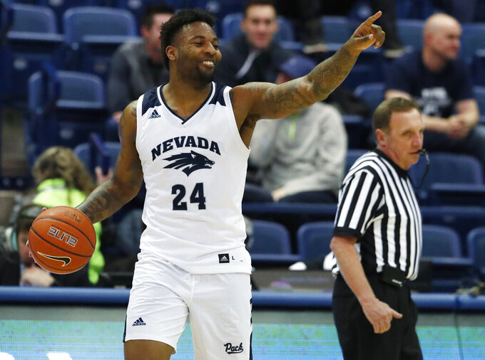 Nevada forward Jordan Caroline gestures to teammates in the waning moments of an NCAA college basketball game against Air Force on Tuesday, March 5, 2019, at Air Force Academy, Colo. Nevada won 90-79. (AP Photo/David Zalubowski)