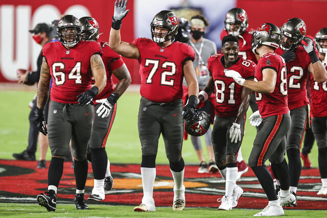The Tampa Bay Buccaneers leave the field after warm-ups during an NFL game against the New Orleans Saints, Sunday, Nov. 8, 2020 in Tampa, Fla. The Saints defeated the Buccaneers 38-3. (Margaret Bowles via AP)
