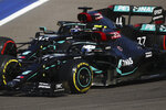 Mercedes driver Valtteri Bottas of Finland, right and Mercedes driver Lewis Hamilton of Britain steer their cars during the Russian Formula One Grand Prix, at the Sochi Autodrom circuit, in Sochi, Russia, Sunday, Sept. 27, 2020. (Bryn Lennon, Pool via AP)