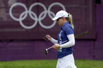 Jodi Ewart Shadoff, of Britian, checks her phone on the 10th green during a practice round prior to the women's golf event at the 2020 Summer Olympics, Tuesday, Aug. 3, 2021, at the Kasumigaseki Country Club in Kawagoe, Japan. (AP Photo/Andy Wong)