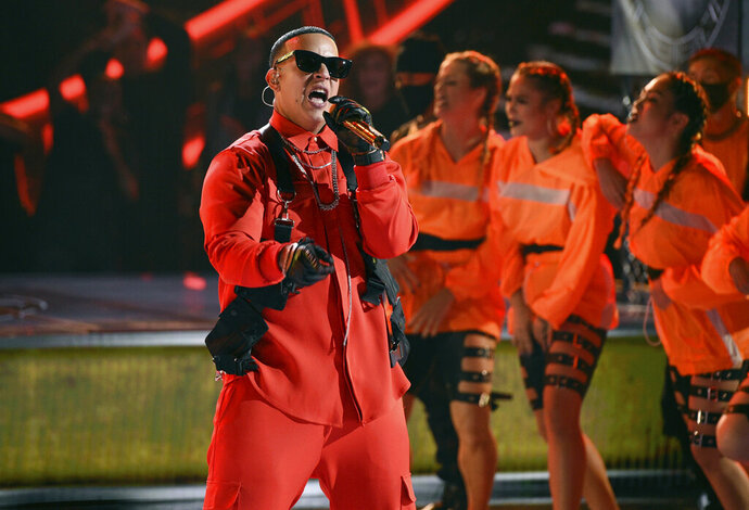FILE - In this Oct. 17, 2019 file photo, Daddy Yankee performs at the Latin American Music Awards, at the Dolby Theatre in Los Angeles. The Puerto Rico reggaeton star is opening a museum Friday, Nov. 22, 2019, in the U.S. Caribbean territory that will be dedicated to his life and the music that made him famous. (Photo by Chris Pizzello/Invision/AP File)