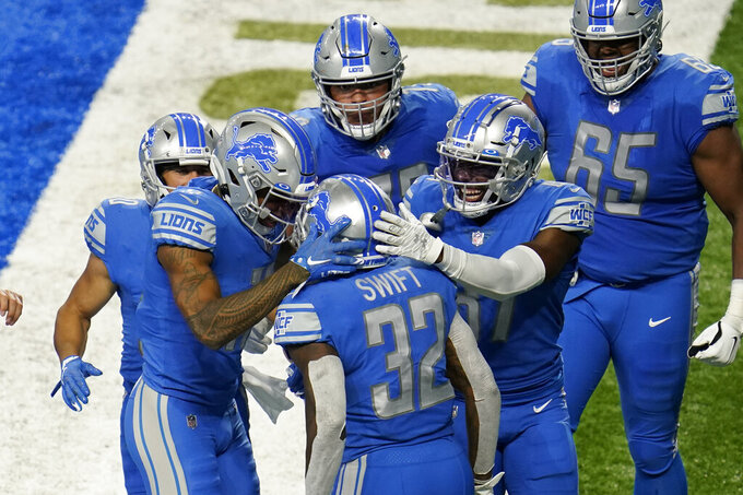 Detroit Lions running back D'Andre Swift (32) celebrates his one-yard touchdown run with teammates in the first half of an NFL football game against the Chicago Bears in Detroit, Sunday, Sept. 13, 2020. (AP Photo/Paul Sancya)