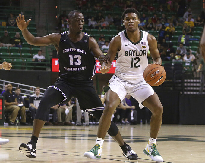 Baylor guard Jared Butler (12) drives up court against Central Arkansas guard Eddy Kayouloud (13) in the second half of an NCAA college basketball game Tuesday, Nov. 5, 2019, in Waco, Texas. (AP Photo/ Jerry Larson)