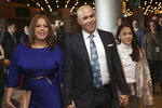 New York Mets new manager Carlos Beltran arrives at an introductory baseball news conference with his family, including his wife Jessica Beltran, left, at Citi Field, Monday, Nov. 4, 2019, in New York.  (AP Photo/Seth Wenig)