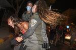 Israeli police arrest a protester near Israeli Prime Minister Benjamin Netanyahu's residence in Jerusalem, Saturday, Sept. 5, 2020. (AP Photo/Ariel Schalit)