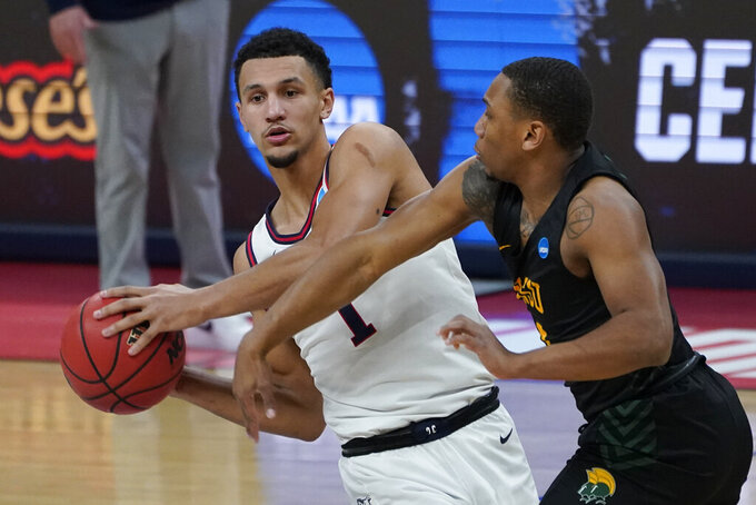 Gonzaga guard Jalen Suggs (1) protects the ball from Norfolk State guard Mustafa Lawrence (3) during the first half of a men's college basketball game in the first round of the NCAA tournament at Bankers Life Fieldhouse in Indianapolis, Saturday, March 20, 2021. (AP Photo/Paul Sancya)