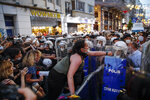 Protesters, left, clash with police officers preventing them from marching against the government's decision to withdraw from Istanbul Convention, in Istanbul, Thursday, July 1, 2021. Turkey formally withdrew Thursday from a landmark international treaty protecting women from violence, and signed in its own city of Istanbul, though President Recep Tayyip Erdogan insisted it won't be a step backwards for women. Hundreds of women demonstrated in Istanbul later Thursday, holding banners that said they won't give up on the Council of Europe's Istanbul Convention. (AP Photo/Kemal Aslan)