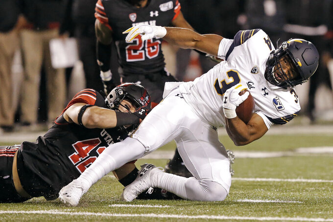 FILE - In this Oct. 26, 2019, file photo, Utah defensive end Mika Tafua (42) tackles California running back Christopher Brown Jr. (34) in the first half of an NCAA college football game in Salt Lake City. Experience is in short supply on the Utah defense as it prepares to head into the pandemic-shortened season. The Utes return only two full-time starters – junior defensive end Tafua and junior linebacker Devin Lloyd – from a unit that took the Pac-12 by storm a year ago. (AP Photo/Rick Bowmer, File)