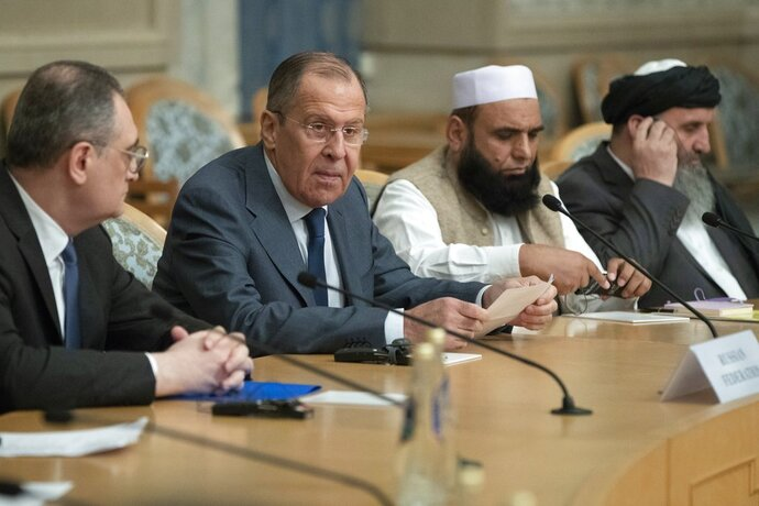Russian Foreign Minister Sergey Lavrov, second left, speaks as he attends a conference on Afghanistan bringing together representatives of the Afghan authorities and the Taliban in Moscow, Russia, Friday, Nov. 9, 2018. The conference marks Moscow's attempt to get the Afghan authorities and the Taliban together at a table. The U.S. Embassy in Moscow has sent a diplomat to observe the discussions. (AP Photo/Pavel Golovkin)