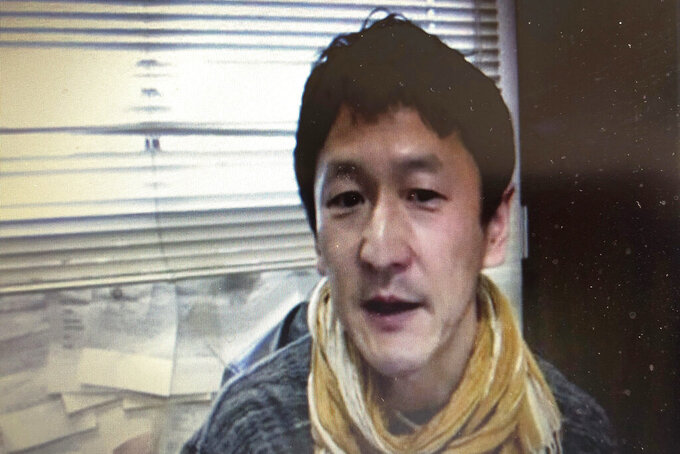 """In this screen shot image made from a video news conference by Foreign Correspondents' Club of Japan (FCCJ) in Tokyo, Japanese professor Kentaro Iwata speaks Monday, April 20, 2020. Iwata says he is """"very pessimistic"""" the Olympics can be held next year in Japan. (FCCJ via AP)"""