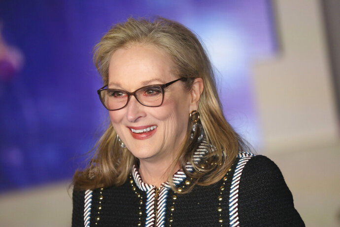"FILE - In this Dec. 12, 2018 file photo, Actress Meryl Streep poses for photographers upon arrival at the 'Mary Poppins Returns' premiere in central London.  Apple TV Plus said Friday, Jan. 17, 2020, Streep will join Chris O'Dowd, Jacob Tremblay and Ruth Negga to give life to Oliver Jeffers' picture book ""Here We Are: Notes for Living on Planet Earth."