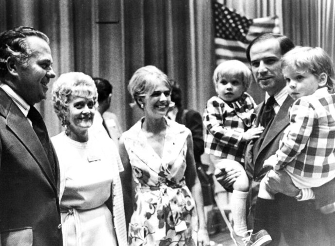 FILE - In this summer 1972 file photo, Joe Biden, carries both of his sons, Joseph, left, and Robert during an appearance at the Democratic state convention At center is his wife Neilia Biden, who was killed in an auto crash, Dec. 20, 1972. With them are Gov.-elect Sherman W. Tribbitt and his wife, Jeanne. (AP Photo)