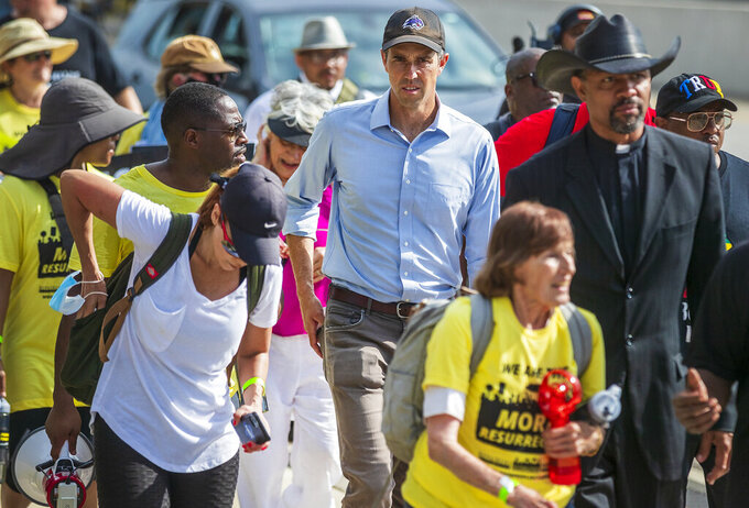 Former Democratic congressman and presidential candidate Beto O'Rourke walks along the service road of Interstate Highway 35, in Georgetown, Texas to participate in a Selma-style march for democracy from Georgetown, Texas to the Texas State Capitol in downtown Austin. On Wednesday, July 28, 2021 the group made a stop at Good Hope church in Round Rock and will end with a rally at the Capitol at 10 am on July 31st. (Ricardo B. Brazziell/Austin American-Statesman via AP)
