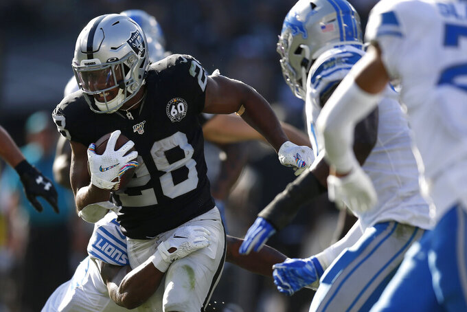 Oakland Raiders running back Josh Jacobs (28) runs against the Detroit Lions during the first half of an NFL football game in Oakland, Calif., Sunday, Nov. 3, 2019. (AP Photo/D. Ross Cameron)