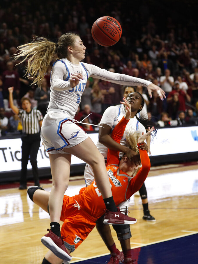 Texas-Rio Grande Valley forward Madison Northcutt, center, (32) is fouled by New Mexico State guard Stabresa McDaniel, right, (3) during a NCAA college basketball Western Athletic Conference Women's Tournament championship game Saturday, March 16, 2019, in Las Vegas. New Mexico State guard Brooke Salas (2) defends at left. (AP Photo/Steve Marcus)