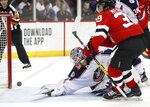 New Jersey Devils right wing Nicholas Merkley (39) watches as his shot comes out of the net after he scored his first career NHL goal, against Columbus Blue Jackets goaltender Elvis Merzlikins (90), during the second period of a hockey game, Sunday, Feb. 16, 2020, in Newark, N.J. (AP Photo/Kathy Willens)