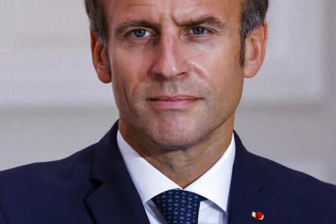 French President Emmanuel Macron looks on during the signing of a new defense deal at The Elysee Palace Tuesday, Sept. 28, 2021 in Paris. France and Greece announced on Tuesday a major, multibillion-euro defense deal including Athens' decision to buy three French warships. (Ludovic Marin, Pool Photo via AP)